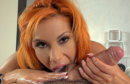 Mulatto girl redhead with hard tits doing a blowjob
