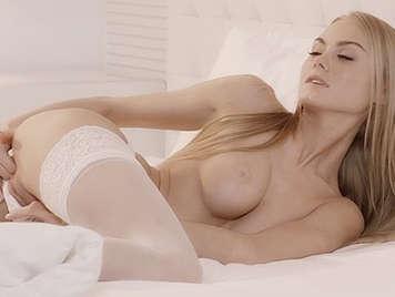 Seductive Ukrainian blonde masturbates sensually while boyfriend watches