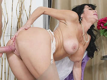 Fucking a luscious milf with big tits on all fours in white lingerie