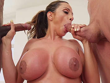 Mature busty doing a spectacular double blowjob with two cocks in her mouth