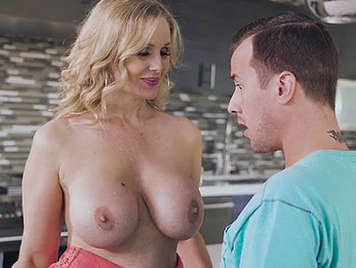 Mature busty blonde fucks a younger guy