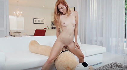 Excited young girl changes the teddy bear for a real cock