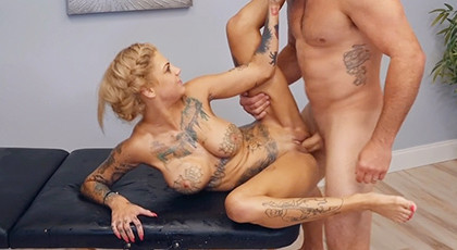 Sex in the masseuse with a tattooed