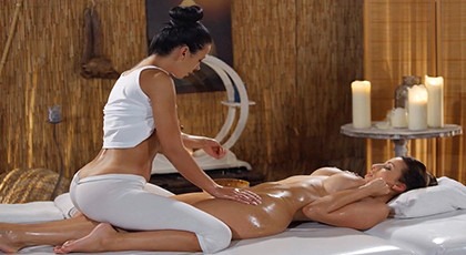 Exotic lesbian massage with a lot of oil