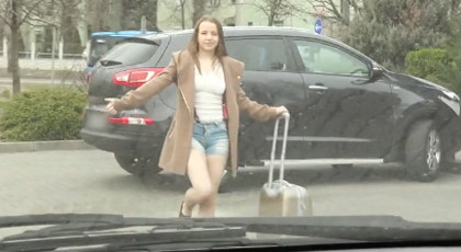 A young Russian woman hitchhiking