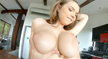 Beautiful babe with a cock between her big tits making it a titjob until he empty the balls of sperm above and between her breasts