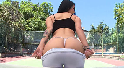 Facial cumshot to buxom brunette with perfect ass, shows her butt on the tennis courts before wildly fucked on all fours like a bitch