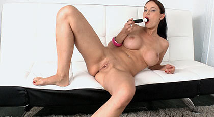 She masturbates with a dildo, while preparing her pussy to be fucked by a hard cock