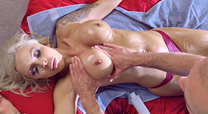 The masseur takes advantage rubbing her beautiful tits and eventually fuck her and cum between her breasts