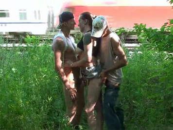 Threesome in public near the railroad tracks