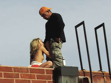 Video voyeur. Little blonde babe sucking and fucking a cock on the roof of a building
