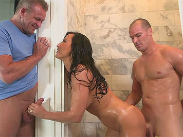 Mature with curves and big tits fucking two cocks in the shower