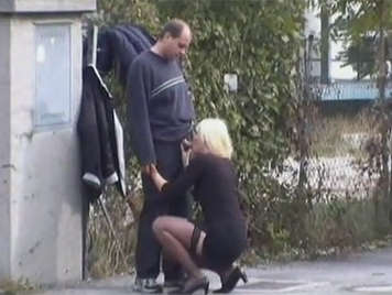 Voyeur records in home video to a Sassy couple fucking in the street