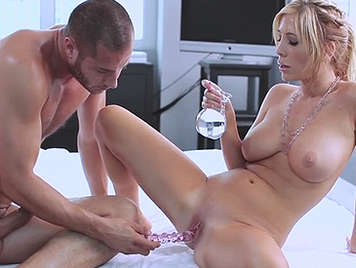 Sex with a busty blonde smeared with lots of oil