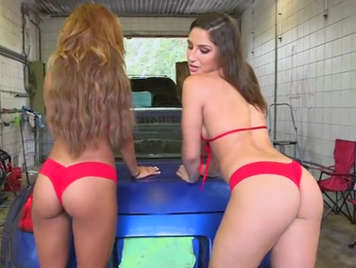 Two sluts with big natural tits and ass in red bikini fucking in a car-wash