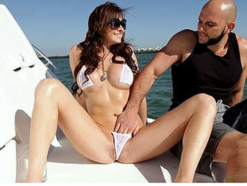 Busty Vixen Twinkie with a spectacular body in bikini covered with oil fucked on a boat