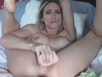 Sexy blonde masturbating with a dildo from compraplacer