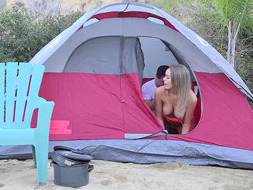She fucks her on the campsite in amateur video.