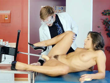 Doctor stimulates the pussy of a patient with a sex machine
