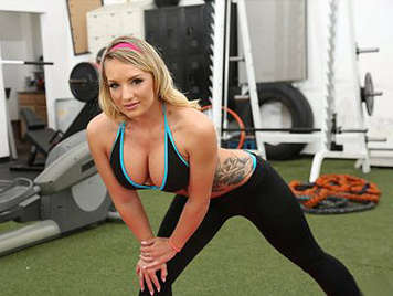 Busty blonde doing a spectacular blowjob in the gym