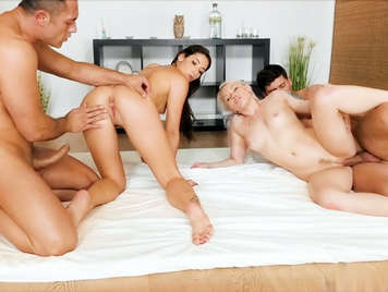 Two couples fucking in a sensual sex quartet