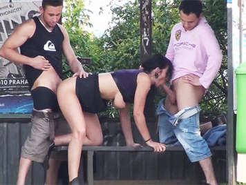 Public sex with a busty brunette fucking with two men at the bus stop