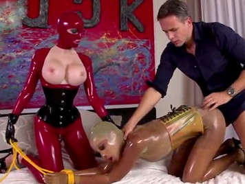 Sexual perversion in latex. Extreme sex and bondage with two sex slaves dressed in latex suits
