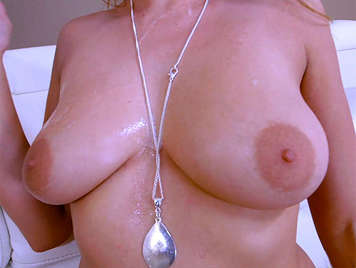 A cumshot over the huge natural tits of a horny blonde