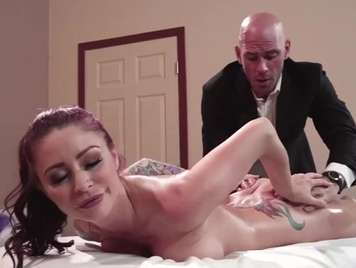 Massage with a lot of oil to a busty redhead