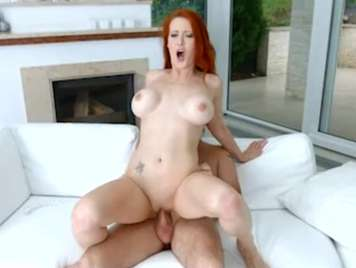Mature redhead wants sex on the couch