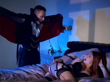 Redhead lingerie celebrates Halloween fucking with Dracula