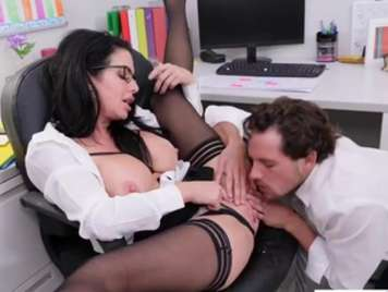 Secretary with glasses fucks with her companion in the office