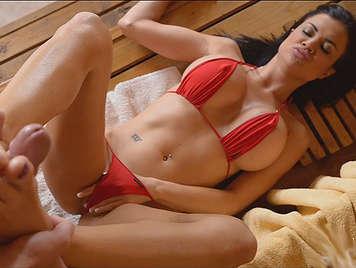 Brunette in bikini jerking with feet in a sauna