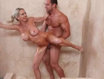 Shower fucking with a busty mature