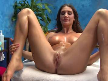 Massage a beautiful busty girl bathed in oil
