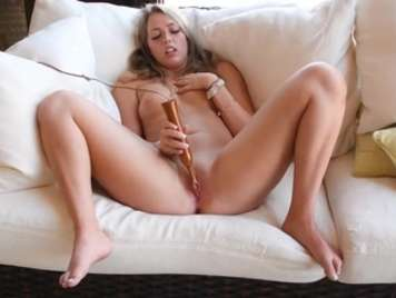 Masturbation young girl is satisfied with a dildo