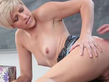 Schoolgirl with short hair is fucked on the table