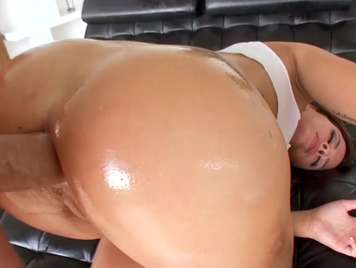 Butt dipped in oil receives hard anal penetration