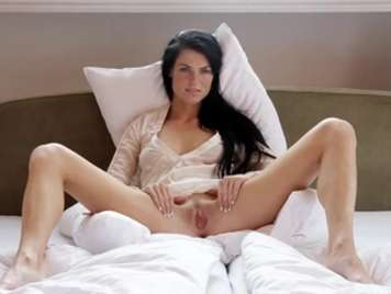 Brunette masturbates in bed for you