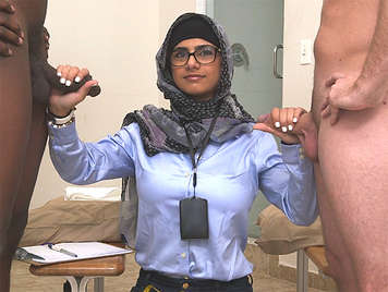 Mia Khalifa milking a black cock and a white cock