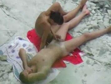 Voyeur films a naked couple