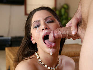 Brunette with big tits plays with a cock in her mouth gets a brutal cumshot in her face