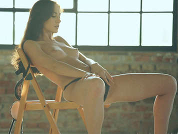 Delicate body beautiful girl masturbating in a chair with her wet sex has an orgasm between gasps of pleasure