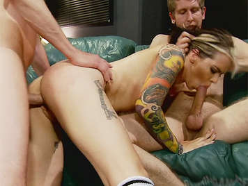 Beautiful and sexy blonde girl tattooed fucked by two huge cocks that fills the body with a torrent of hot cum