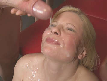 A busty blonde gets her husband a gift for his birthday which consists of a bukkake session that ends with a face covered by semen than 12 cocks
