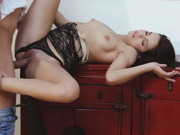 A young slut in sexy lingerie enjoys a cock in her pussy will be cum between the her toes