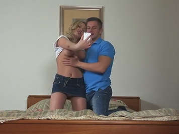 Amateur couple recording a home video with anal sex